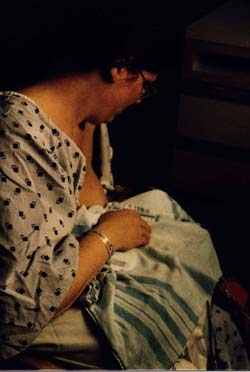 Breastfeeding Adam for the first time 9 days after birth without a supplementary feeding device